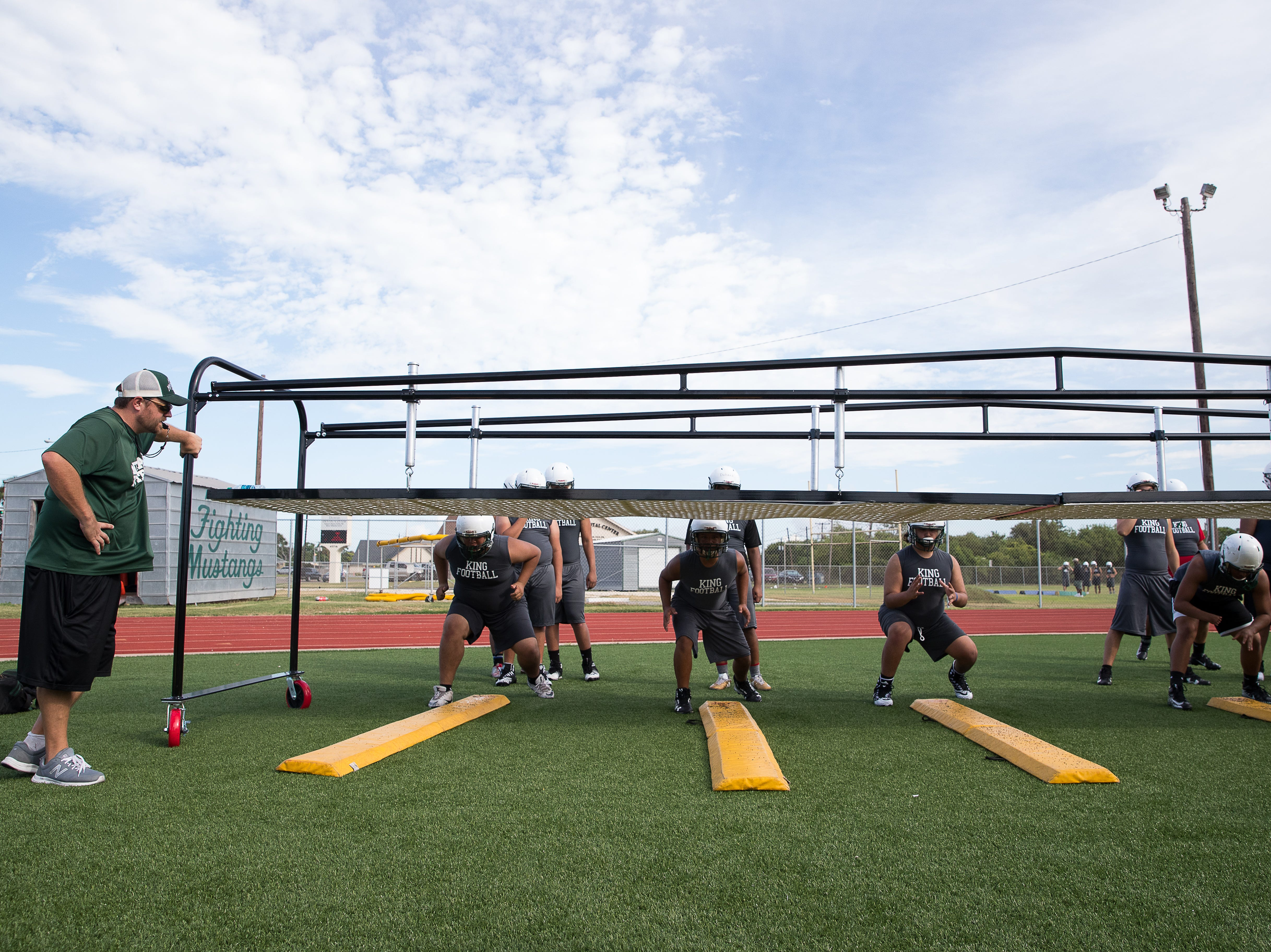 King football players run drills on the first day of practice for the 2018 season at King High School on Monday, Aug. 6, 2018.