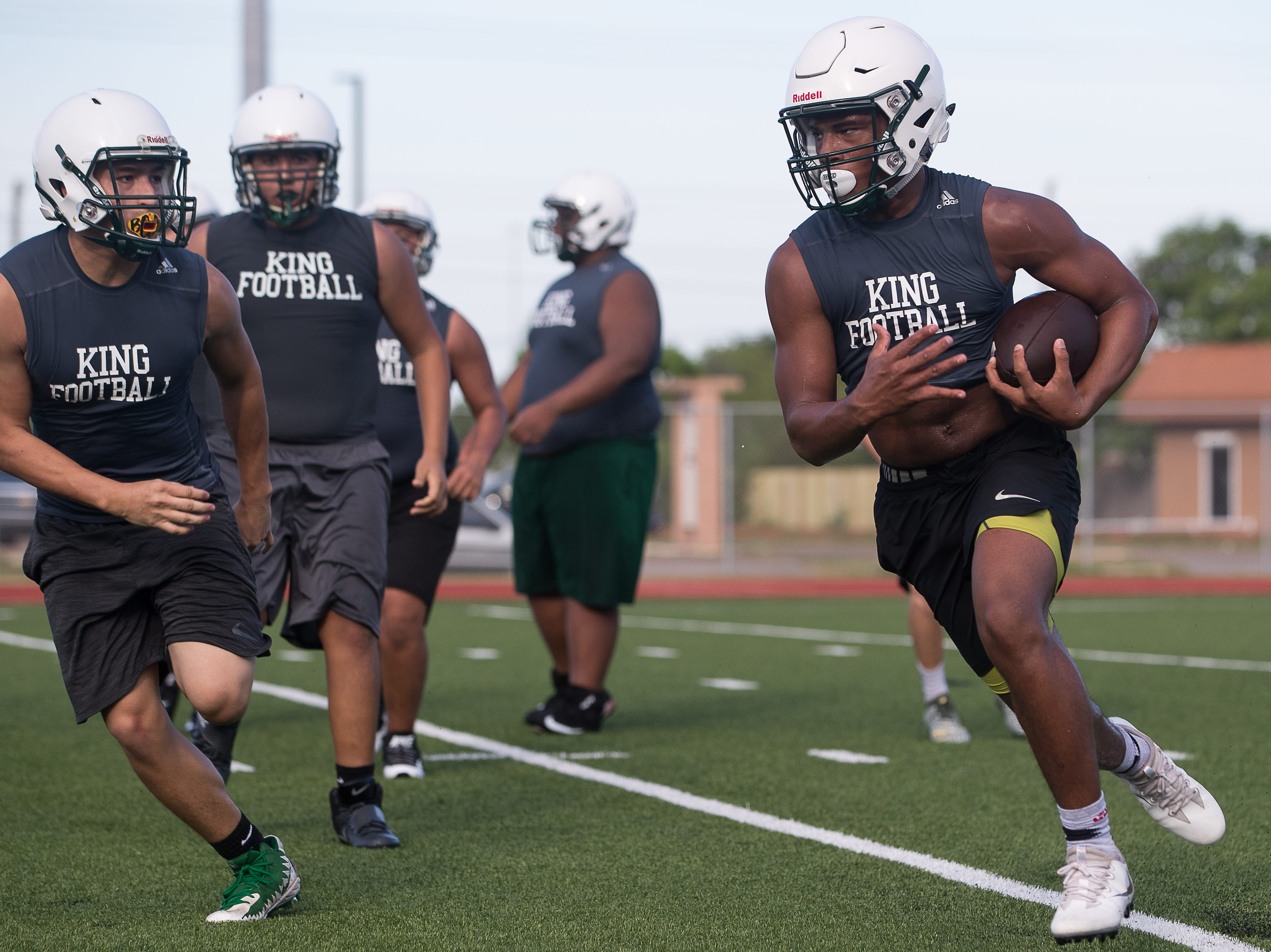 King's Bryson Butler runs a drill on the first day of practice for the 2018 season at King High School on Monday, Aug. 6, 2018.