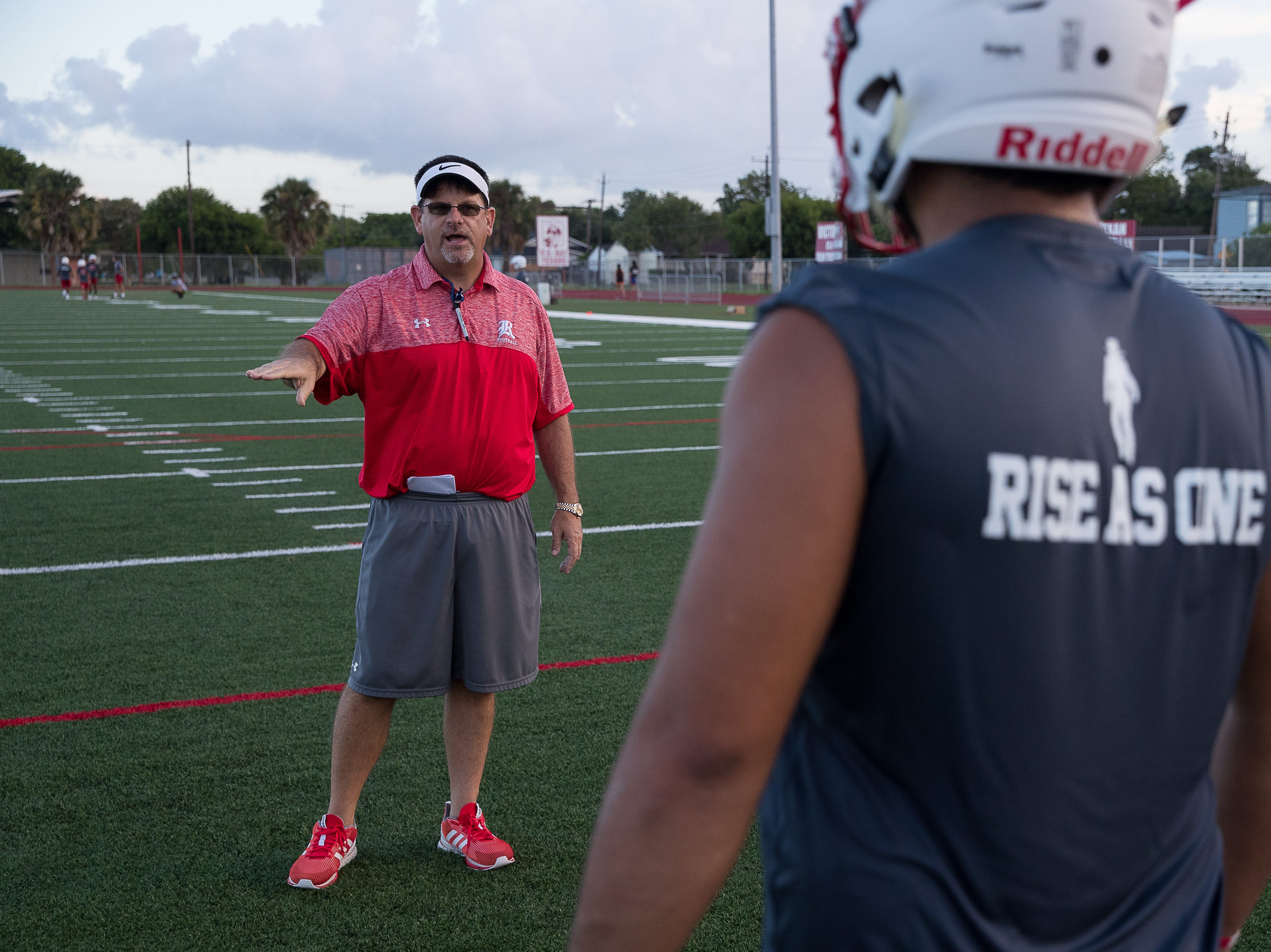 Ray head coach Craig Charlton talks to his players on the first day of practice for the 2018 season at Ray High School on Monday, Aug. 6, 2018.