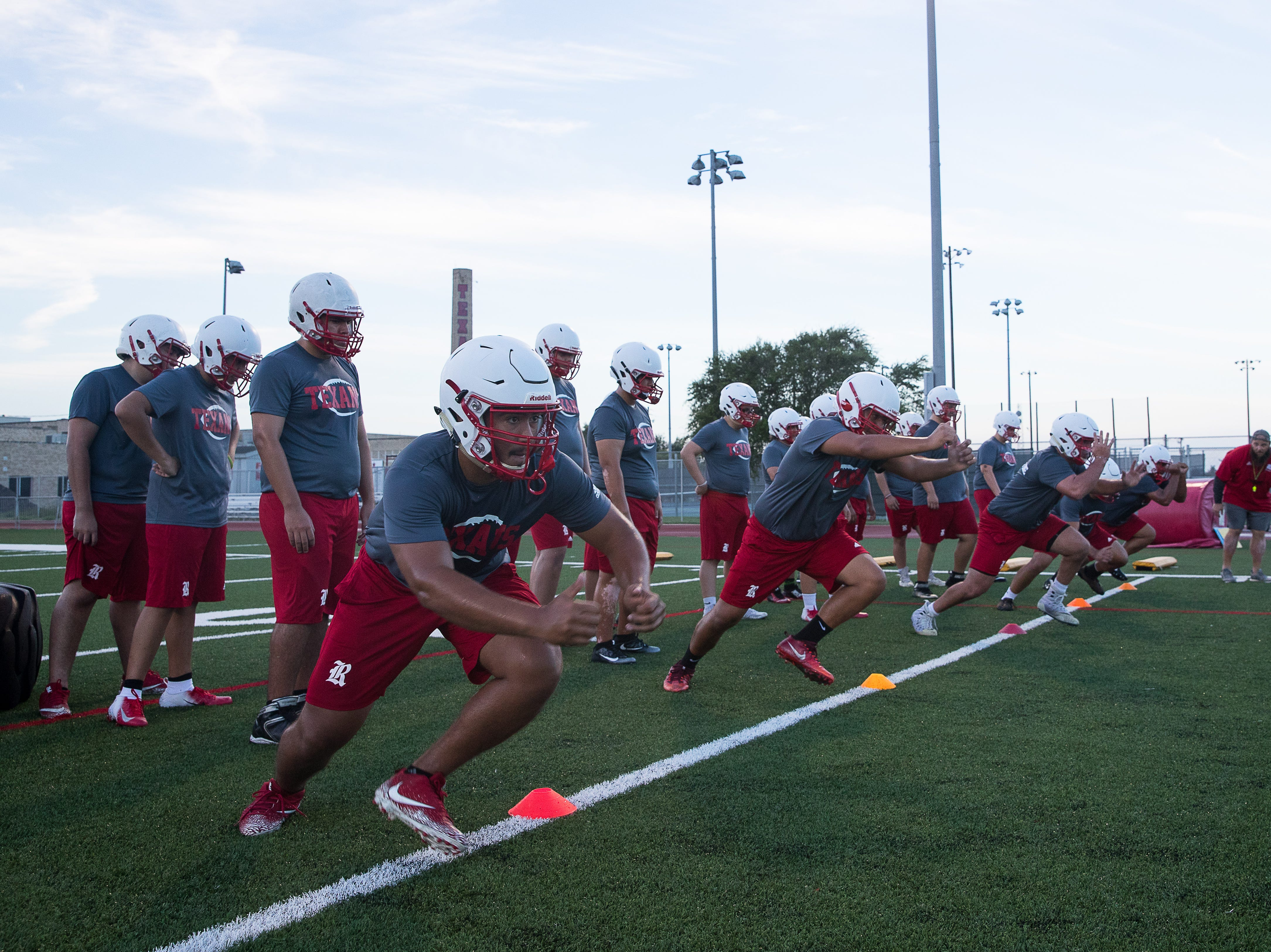 Ray football players run drills on the first day of practice for the 2018 season at Ray High School on Monday, Aug. 6, 2018.