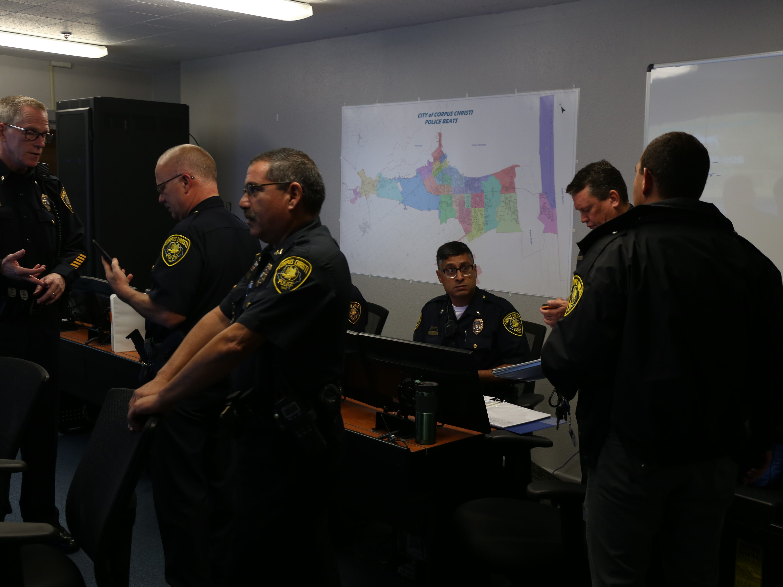 Corpus Christi police officers discuss Hurricane Harvey plans.
