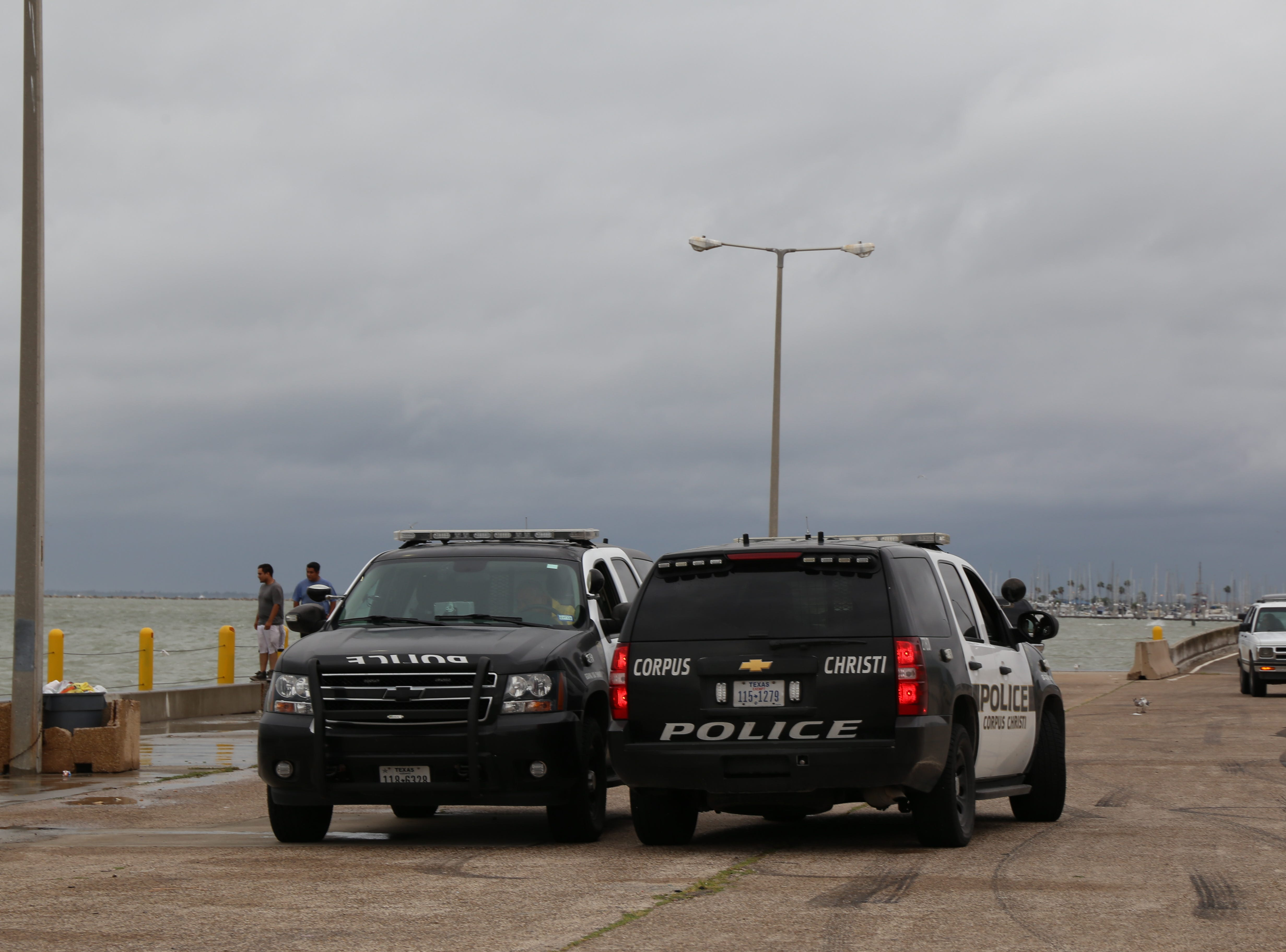 Corpus Christi police officers park their vehicles near Corpus Christi Bay in front of the American Bank Center after Hurricane Harvey.