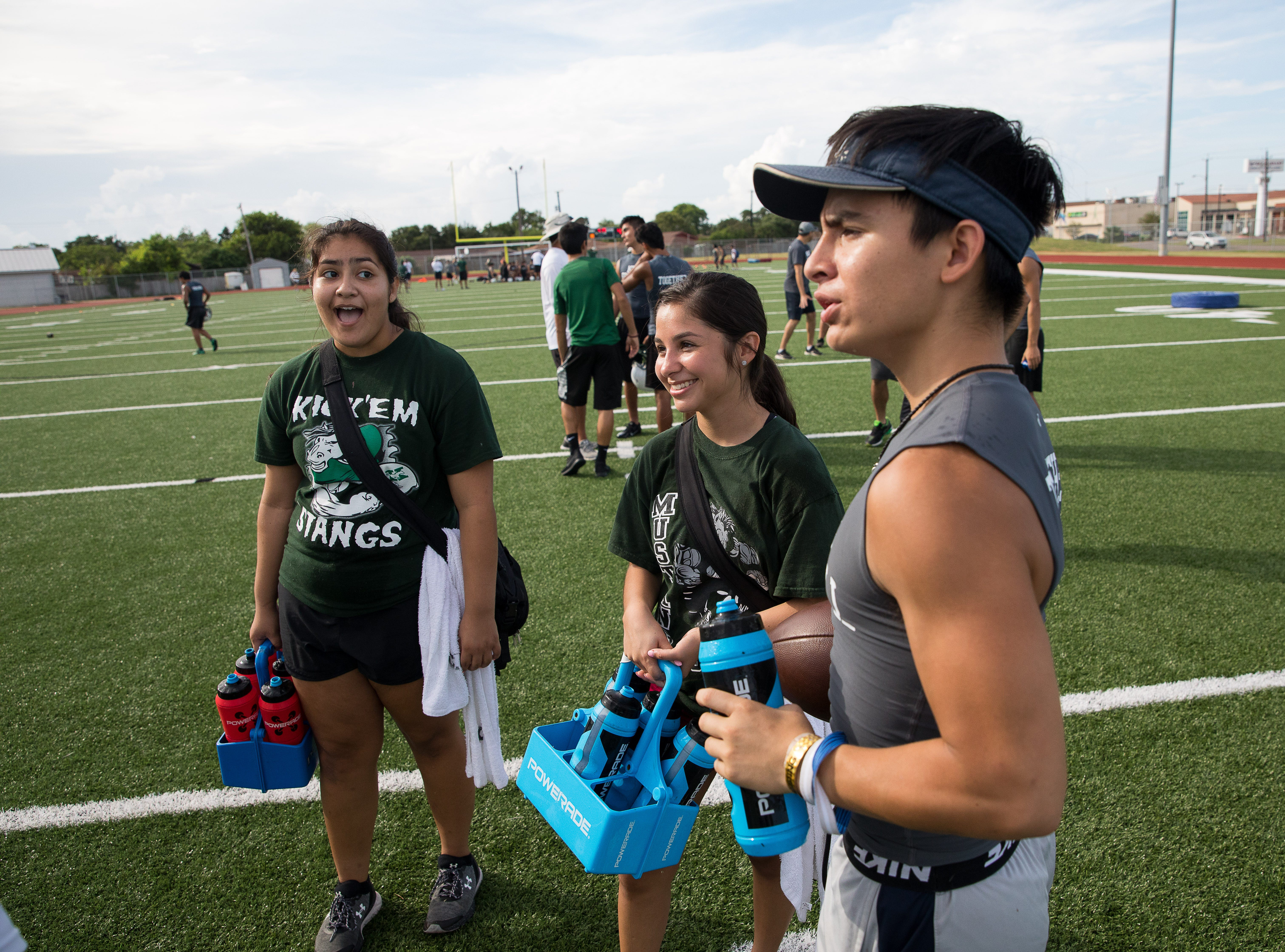 King football trainers hand out water on the first day of practice for the 2018 season at King High School on Monday, Aug. 6, 2018.