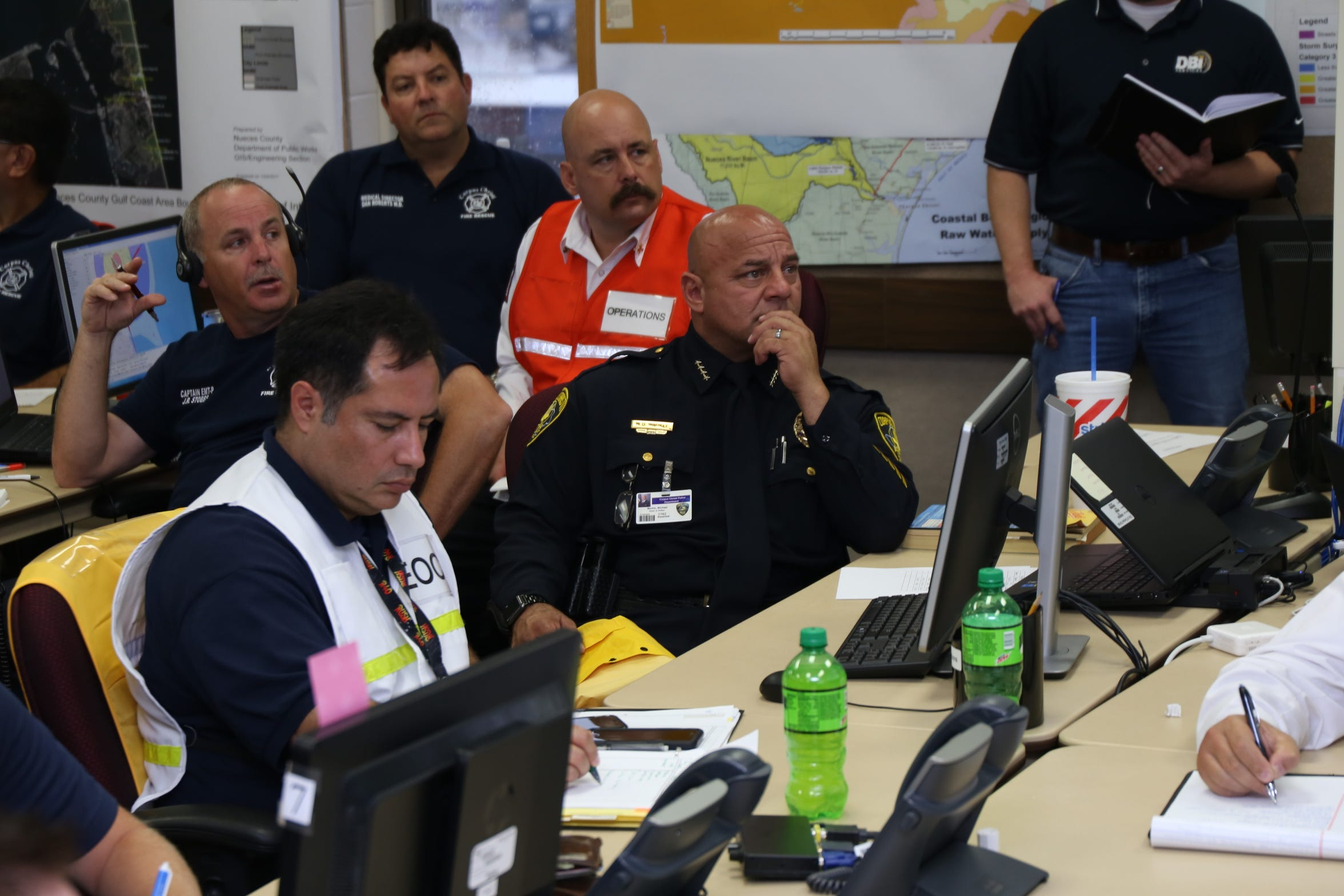 Deputy Fire Chief Richie Quintero, left, and Corpus Christi Chief of Police Mike Markle attend a Hurricane Harvey briefing at the Emergency Operations Center.