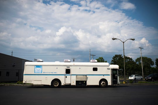 A mobile clinic from The John Brooks Recovery Center is parked outside the Pleasantville, N.J. location Monday, Aug. 6, 2018. The bus is used to deliver methadone to prisoners.