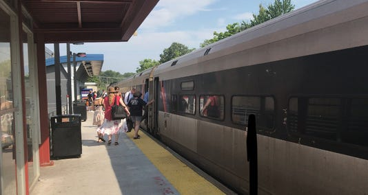 Passengers board NJ Transit train to Atlantic City