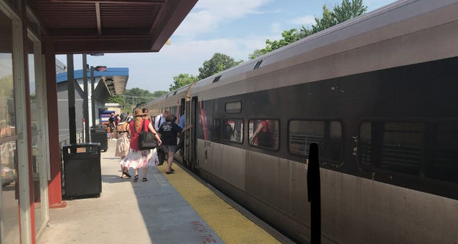Passengers board NJ Transit train to Atlantic City