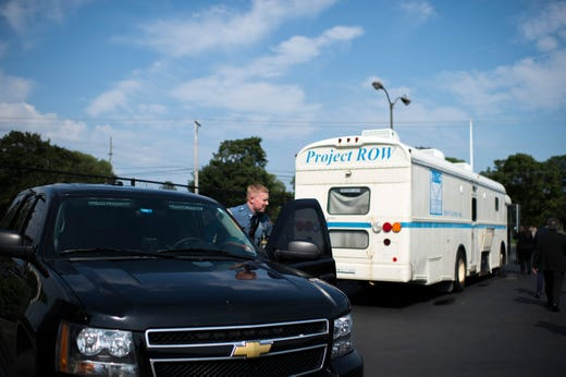 A correctional officer who wishes to be unnamed stands outside the John Brooks Recovery Center Monday, Aug. 6, 2018 in Pleasantville, N.J. The bus is used as a mobile clinic that delivers methadone to the jail.