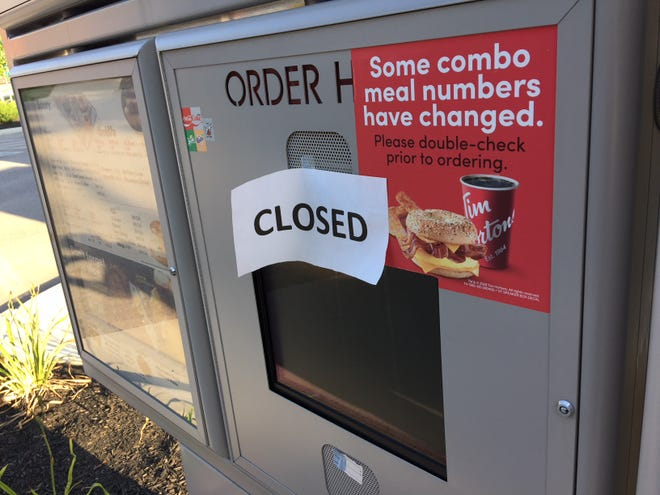 """A """"closed"""" sign was found at the Tim Horton's Erlanger location Monday morning."""