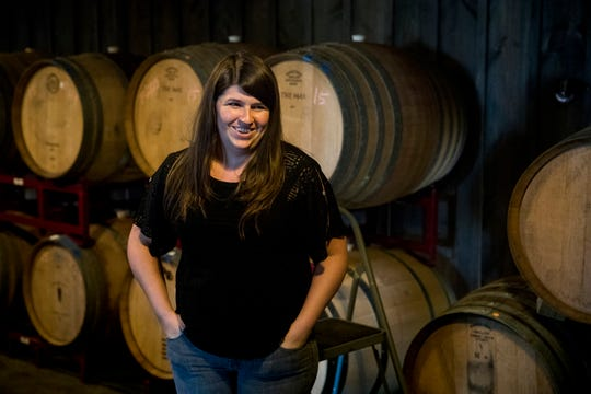 Kate MacDonald, of Skeleton Root Winery, stands in her barrel room where her recreation Nicholas Longworth's Catawba wine has been resting for the past four years.