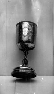 "Nicolas Longworth, a famed wine maker, awarded this cup to Sebastian Rentz, a Delhi Township man, in 1856 for his Catawba wine. The cup reads ""the best Catawba wine, portage 1856."""