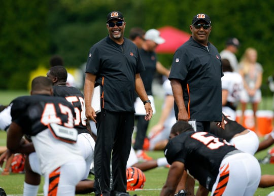 Cincinnati Bengals defensive coordinator Teryl Austin and head coach Marvin Lewis watch over stretches before a training camp practice at the Paul Brown Stadium training facility in downtown Cincinnati on Monday, Aug. 6, 2018.