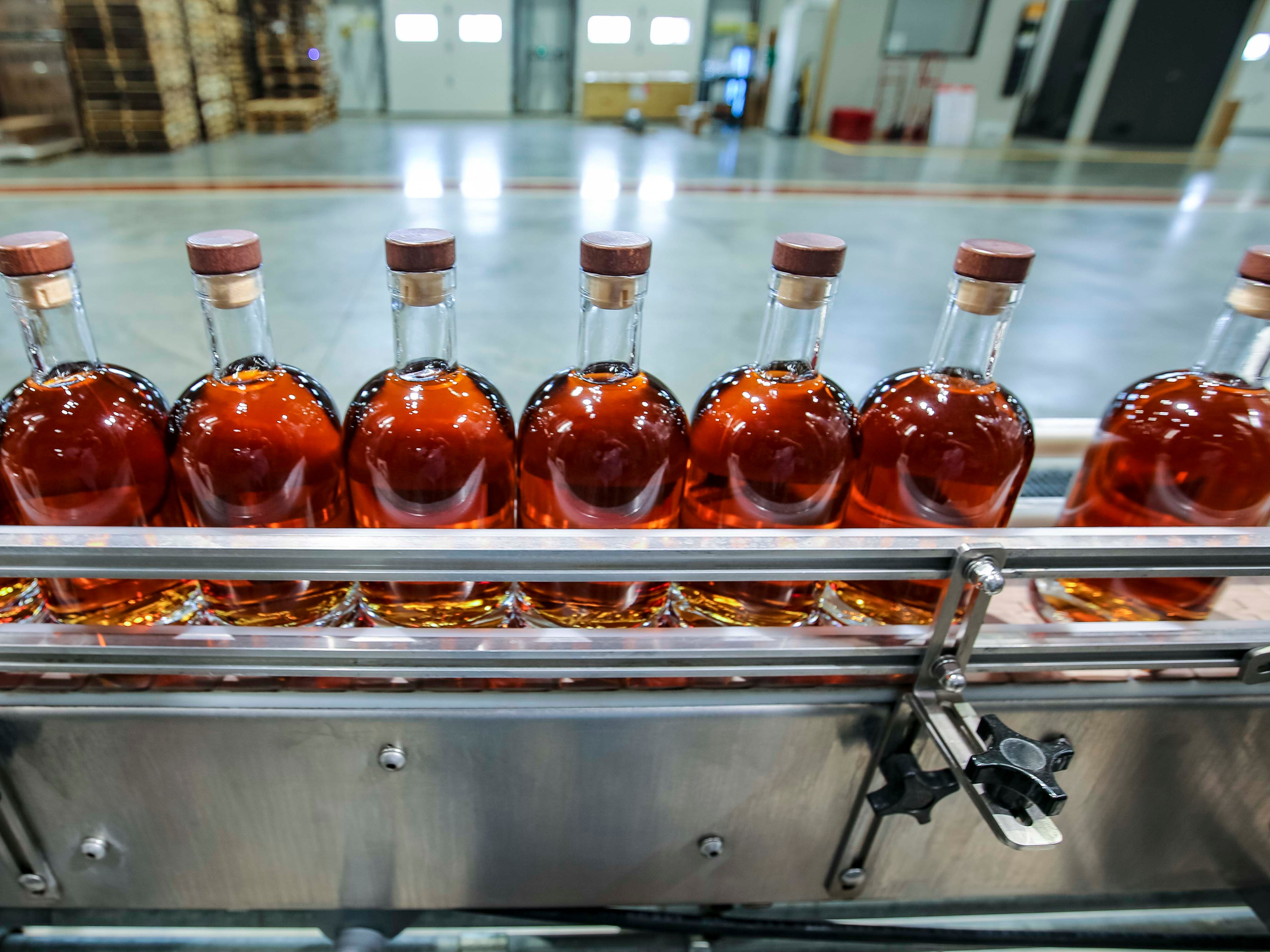 Workers bottle Templeton Rye in their new $35 million distillery in Templeton, Iowa, shown here Monday, Aug. 6, 2018, featuring a museum and visitor's center.