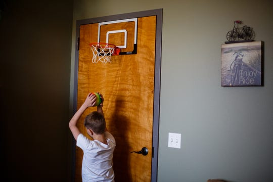 Sam Barlage plays a game of basketball during a regular therapy session with Psychologist David Grove at Compass Clinical Associates on Thursday, March 8, 2018, in Urbandale. Sam, 10, has serious mental illness, including bipolar disorder and the game gives him an outlet so he can then focus on the exercises Dr. Grove wants him to accomplish. His mother, Carrie Clogg, has become an outspoken activist on behalf of improving IowaÕs mental-health system for children, which is almost non-existent.