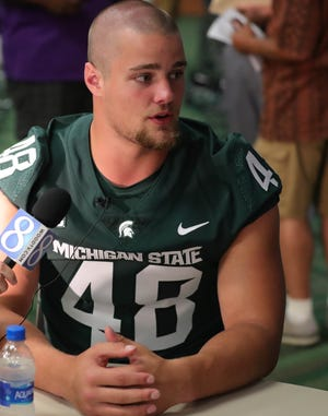 Michigan State defensive end Kenny Willekes talks with reporters about the upcoming season on Monday, Aug. 6, 2018, in East Lansing.