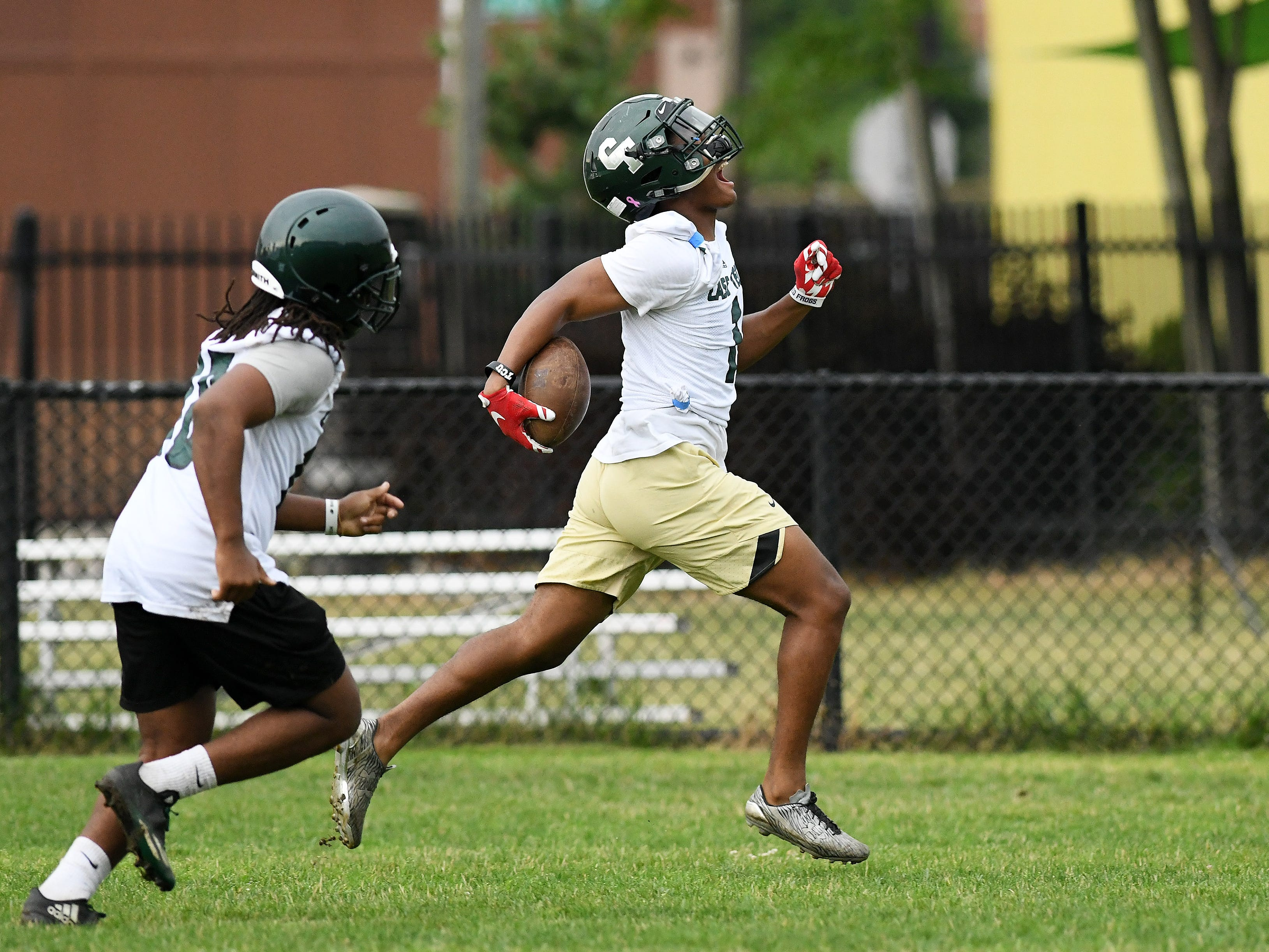 Running back Jaren Mangham runs back a kick during special teams drills at football practice at Cass Technical High School in Detroit on Aug. 6, 2018.