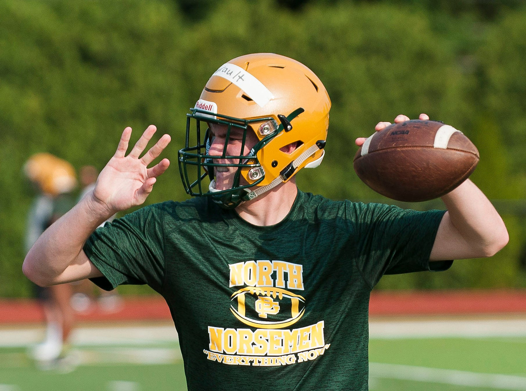 Quarterback Joe Ayrault throws a pass during the first practice of the season Monday.