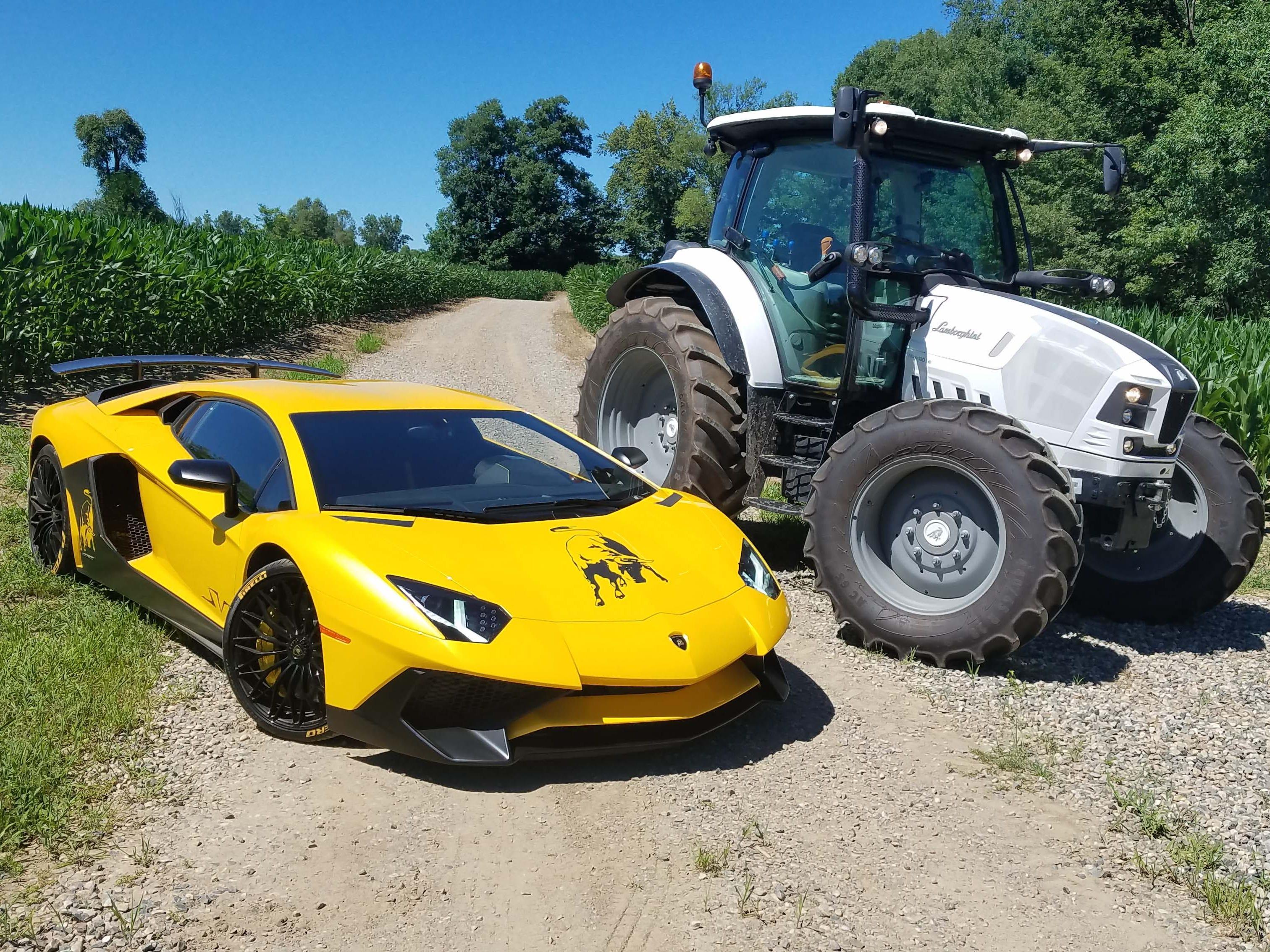 Siblings. The 74-horsepower Lamborghini Aventador supercar and the 127-horse Lamborghini Nitro farm tractor in the cornfields of Metamora.