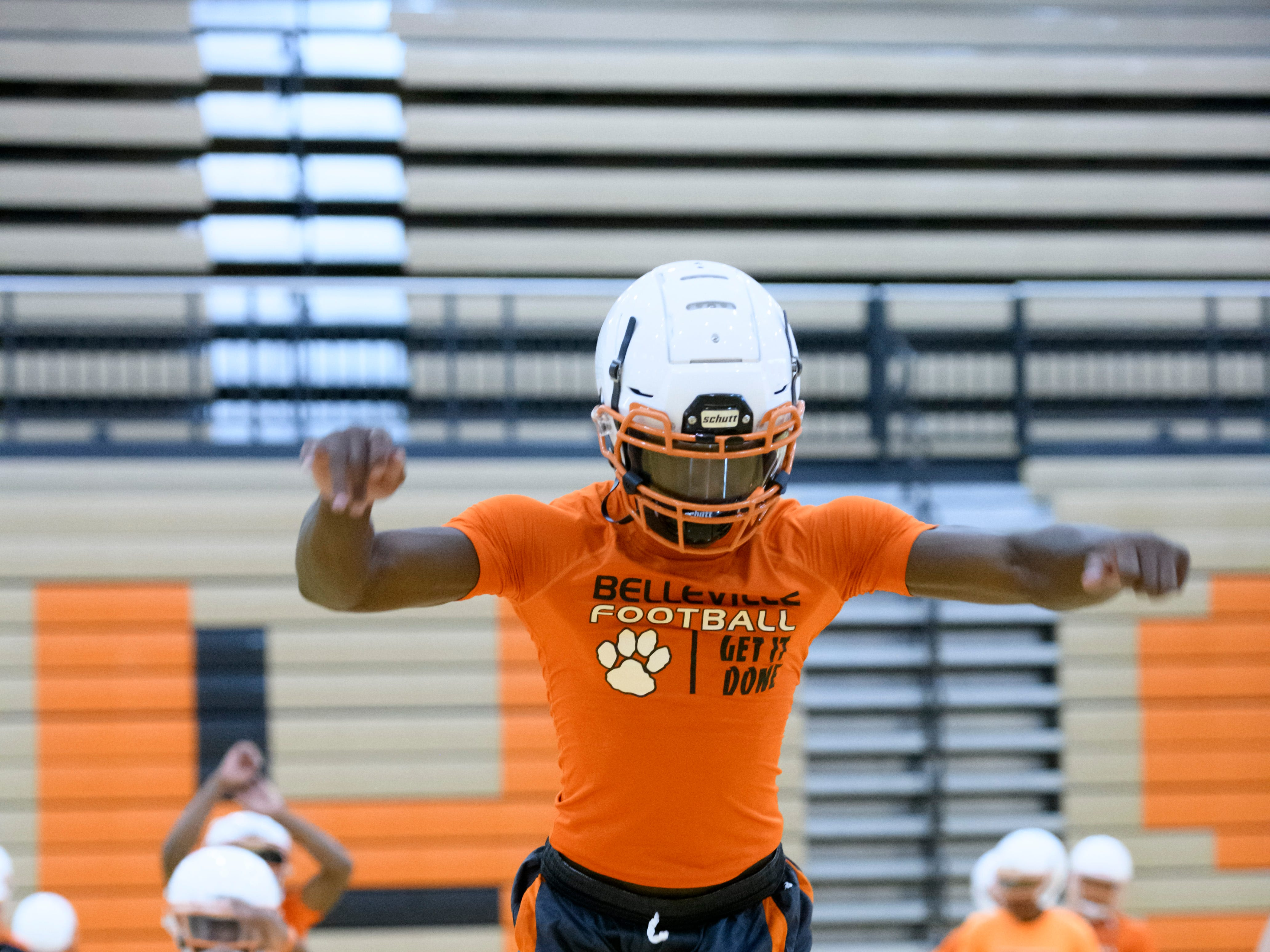 Belleville's Julian Barnett leaps forward while working out in the gym.