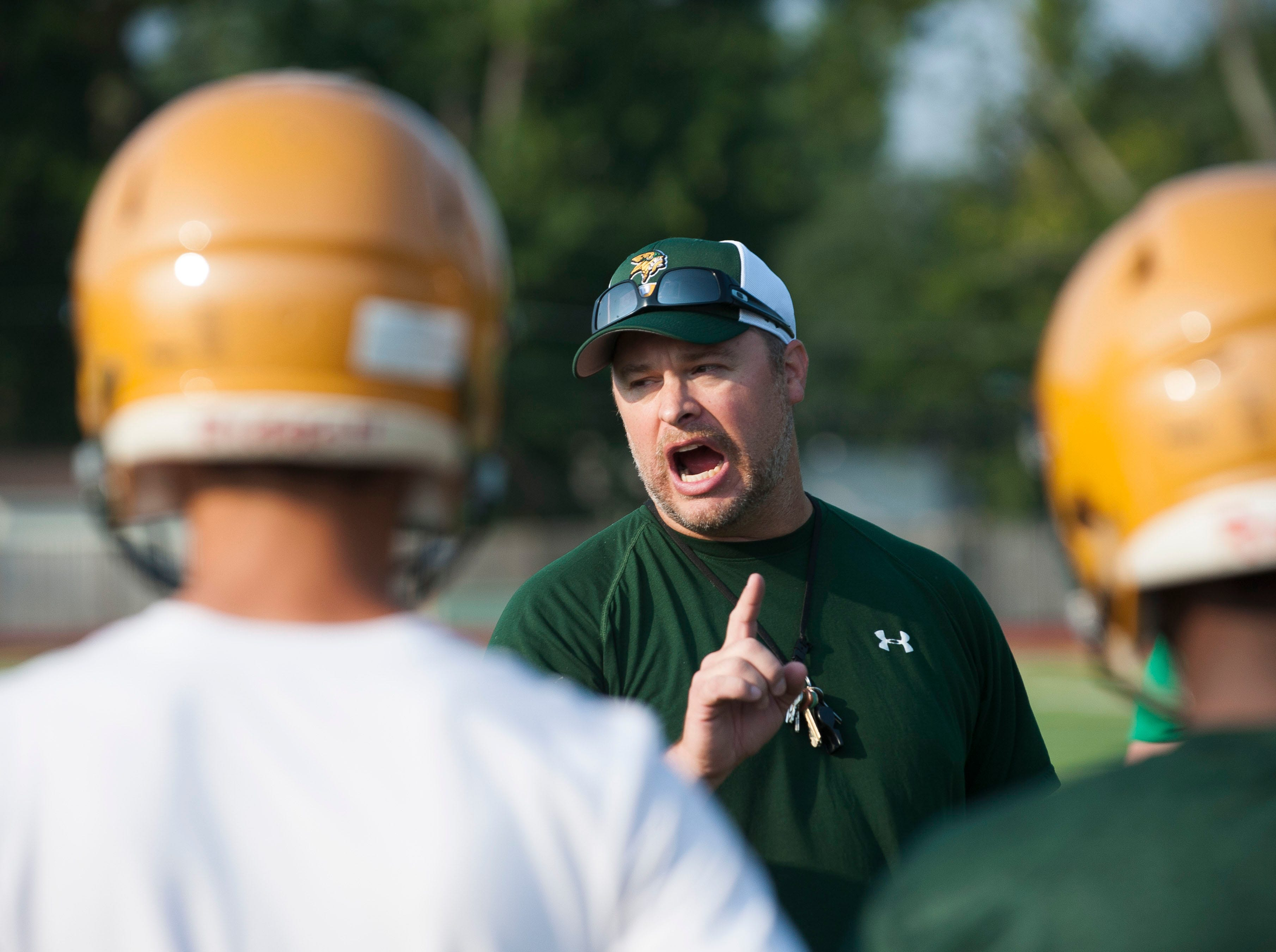New head coach Joe Drouin leads the Grosse Pointe North football team in their first practice of the season on Monday, Aug. 6, 2018. Drouin replaces longtime North football coach Frank Sumbera.
