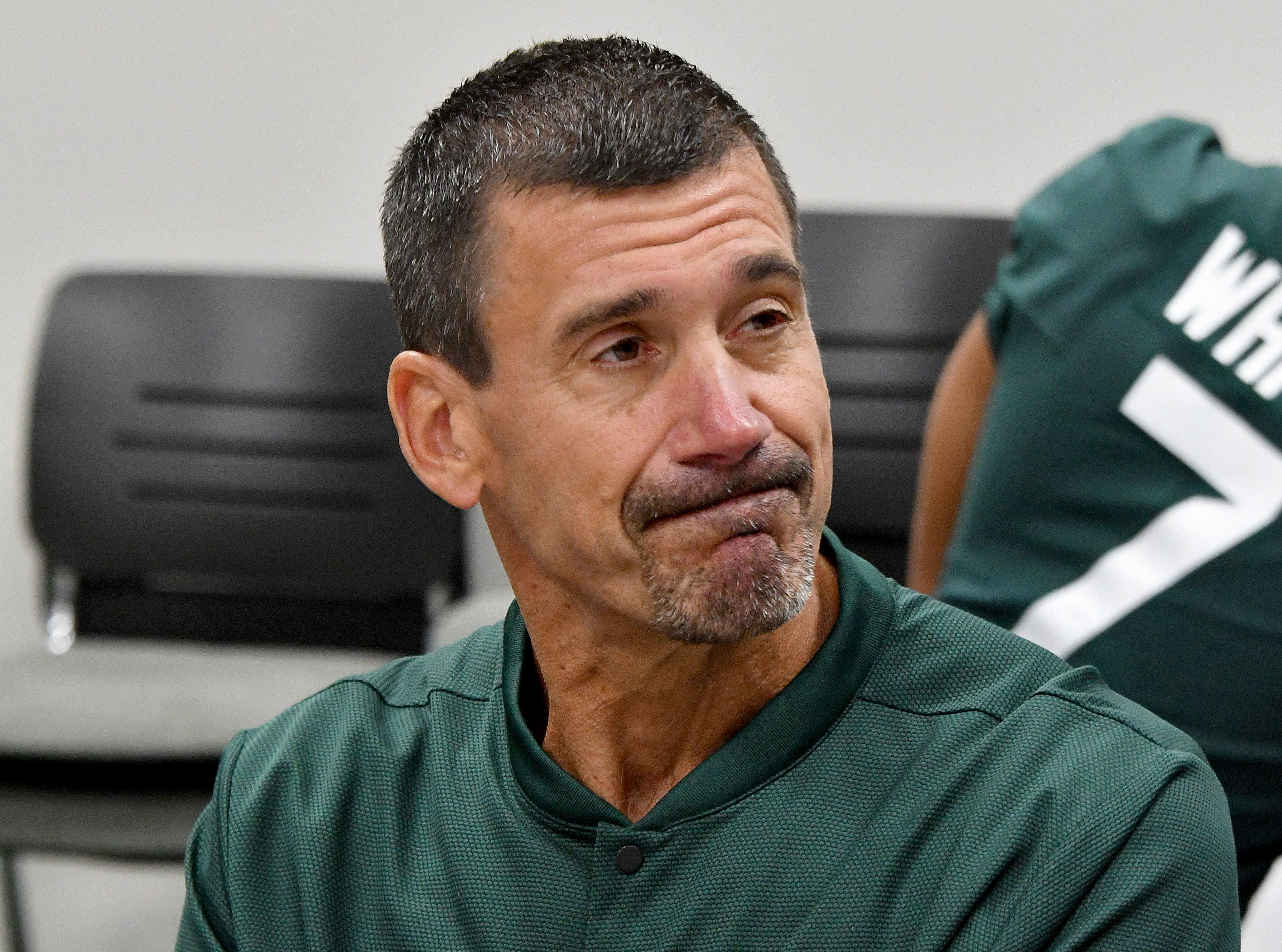 Quarterbacks coach Brad Salem makes a face as he ponders a question by a reporter.