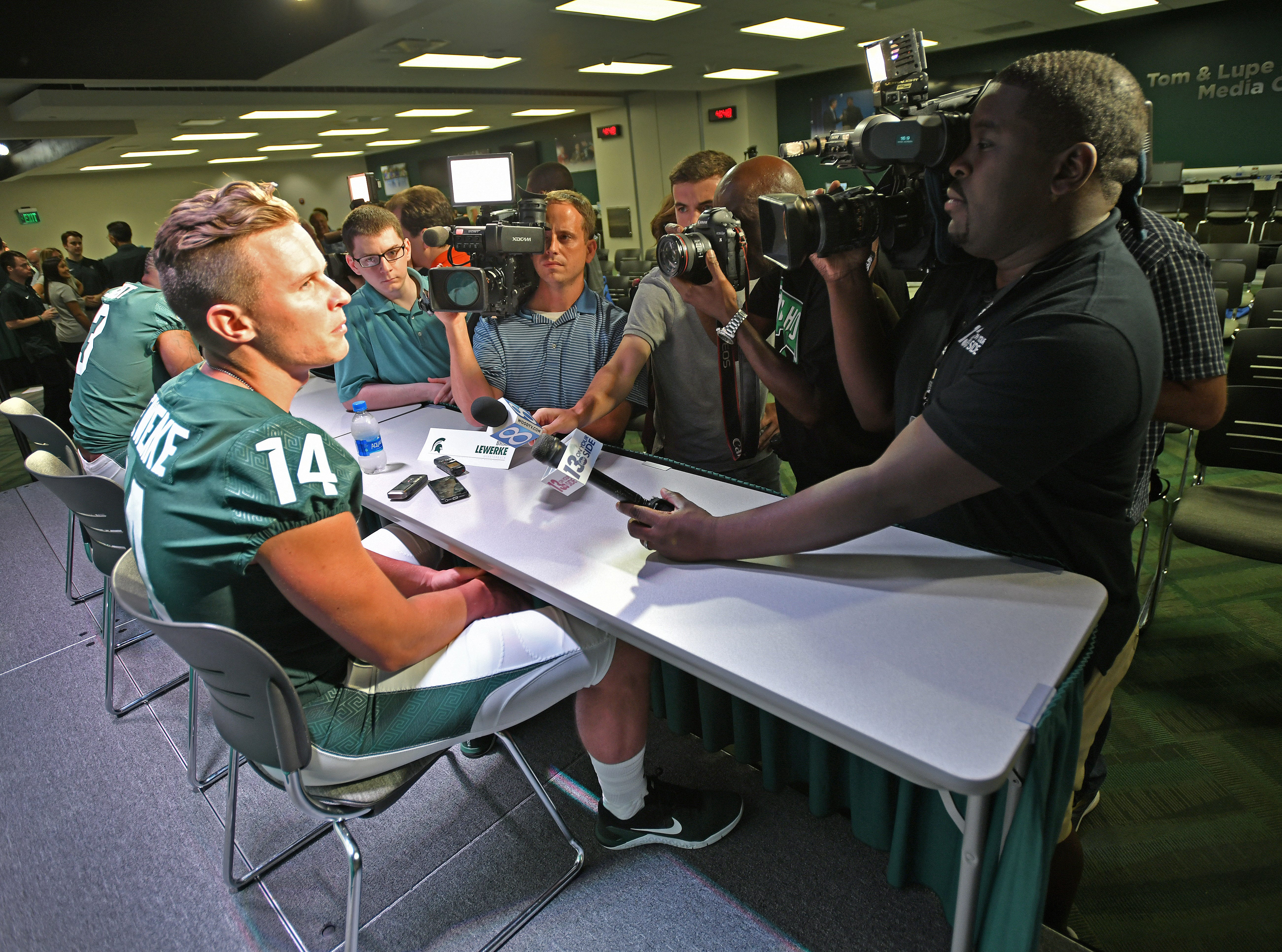 As you might expect for a starting quarterback, Brian Lewerke was mobbed by the media at Michigan State's annual football media day on Aug. 6, 2018, at Spartan Stadium in East Lansing.