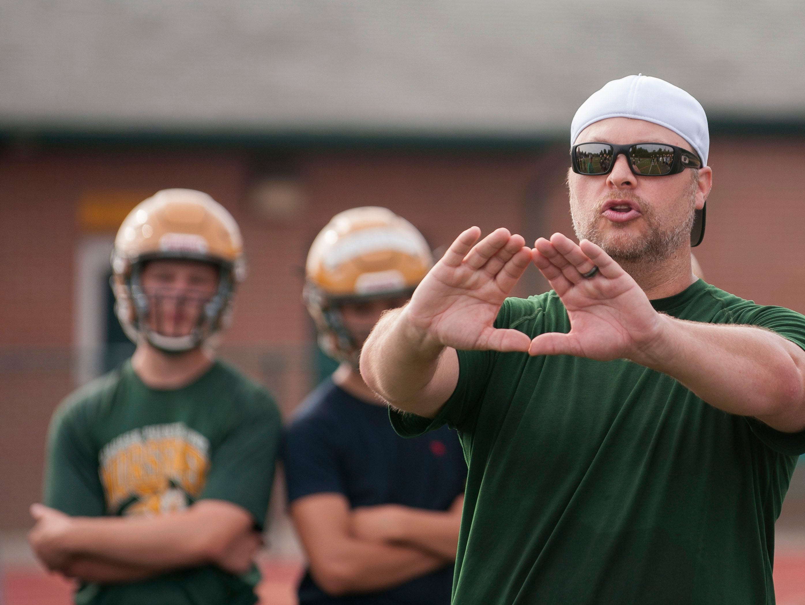 New head coach Joe Drouin leads the Grosse Pointe North football team in their first practice of the season Monday in Grosse Pointe Woods.