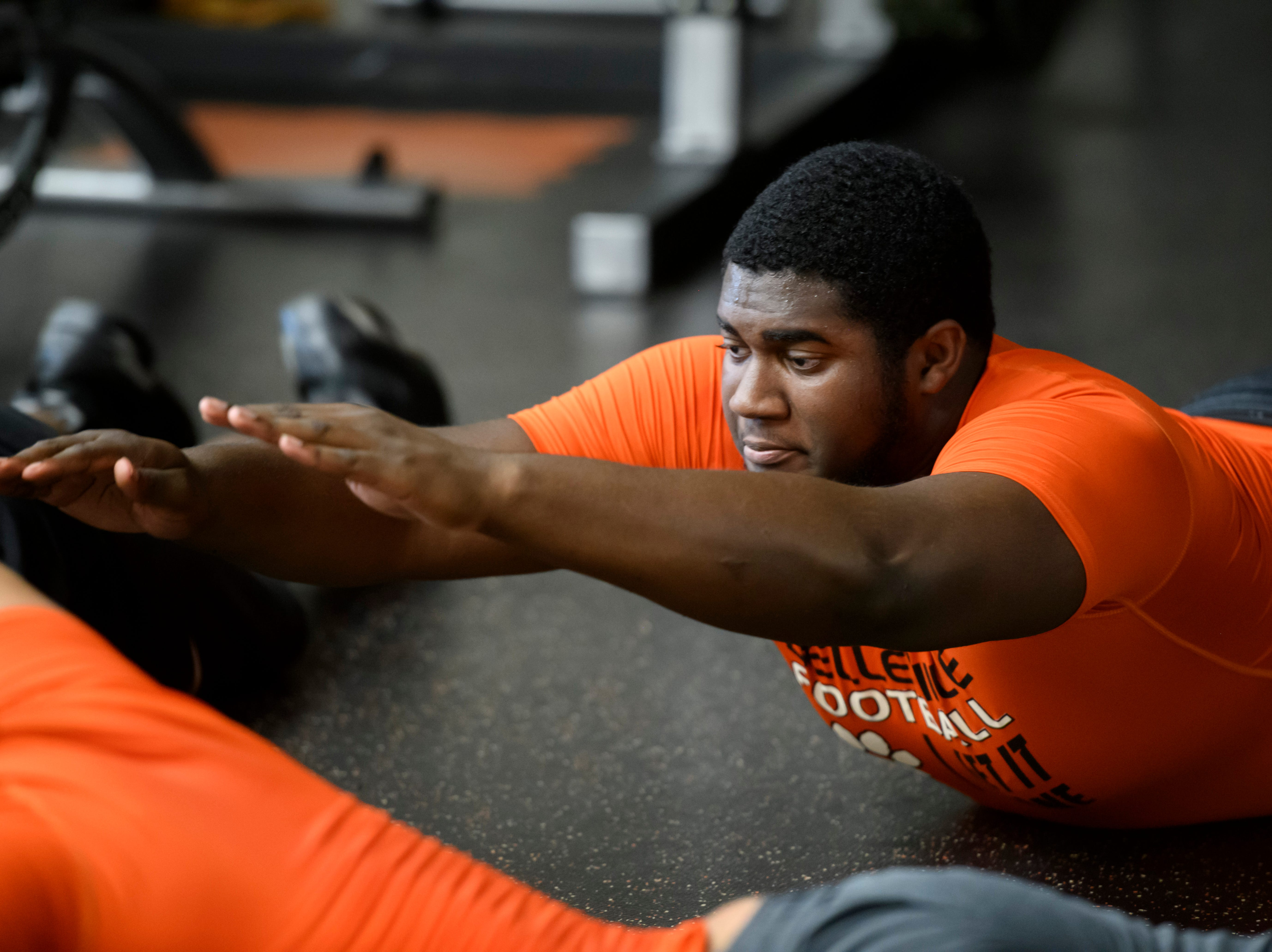 Belleville's Devontae Dobbs works out in the weight room.