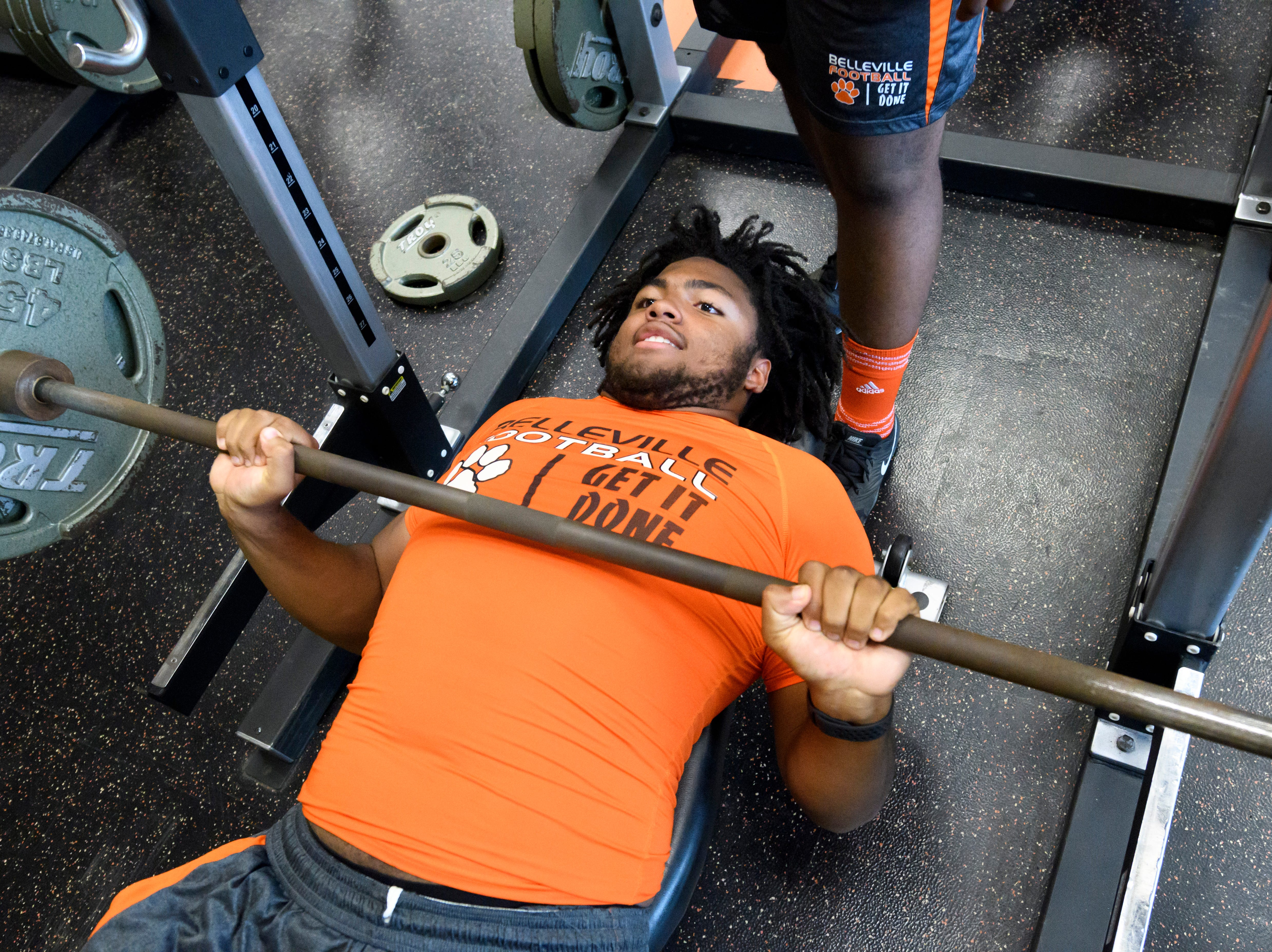Belleville's Tyrece Woods works out in the weight room.