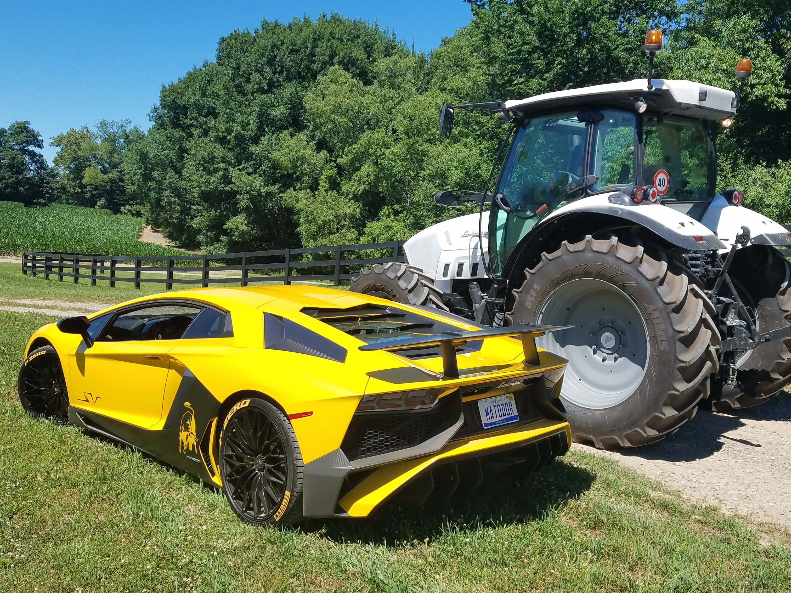 Separated at birth? The Lamborghini Aventador SV, left, is a track-focused, 217-mph hellion with poor visibility. The Lamborghini Nitro tractor is a farm-focused, 31-mph worker bee with excellent visibility.