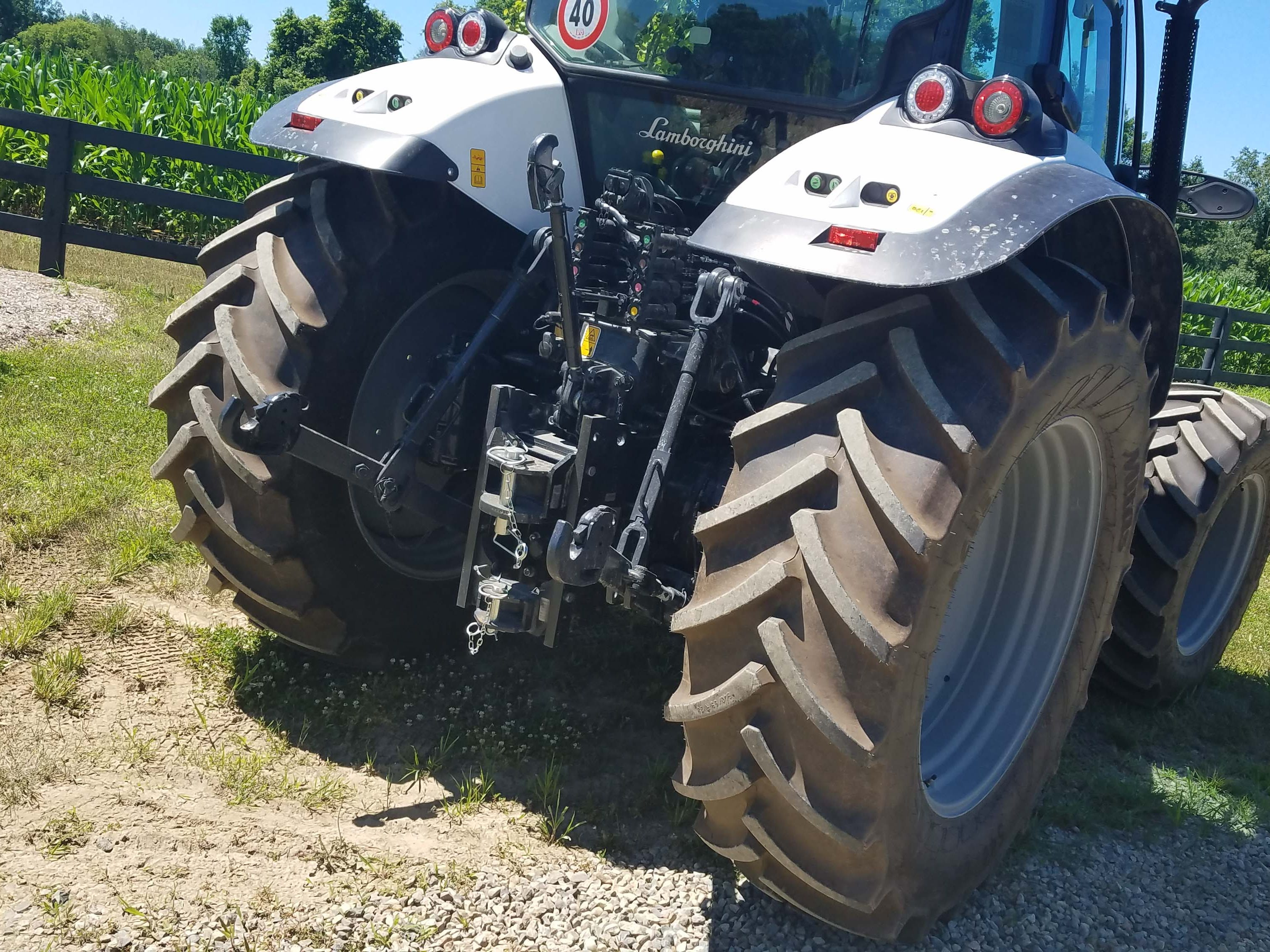 The business end of the Lamborghini Nitro. Its multiple electronic and hydraulic hookups are used for farm implements. The quick tractor also excels at high-speed operations with a front loader.