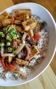 Vegetarians have plenty of choices at Maidens, including this ginger and tofu stir fry with fresh veggies.