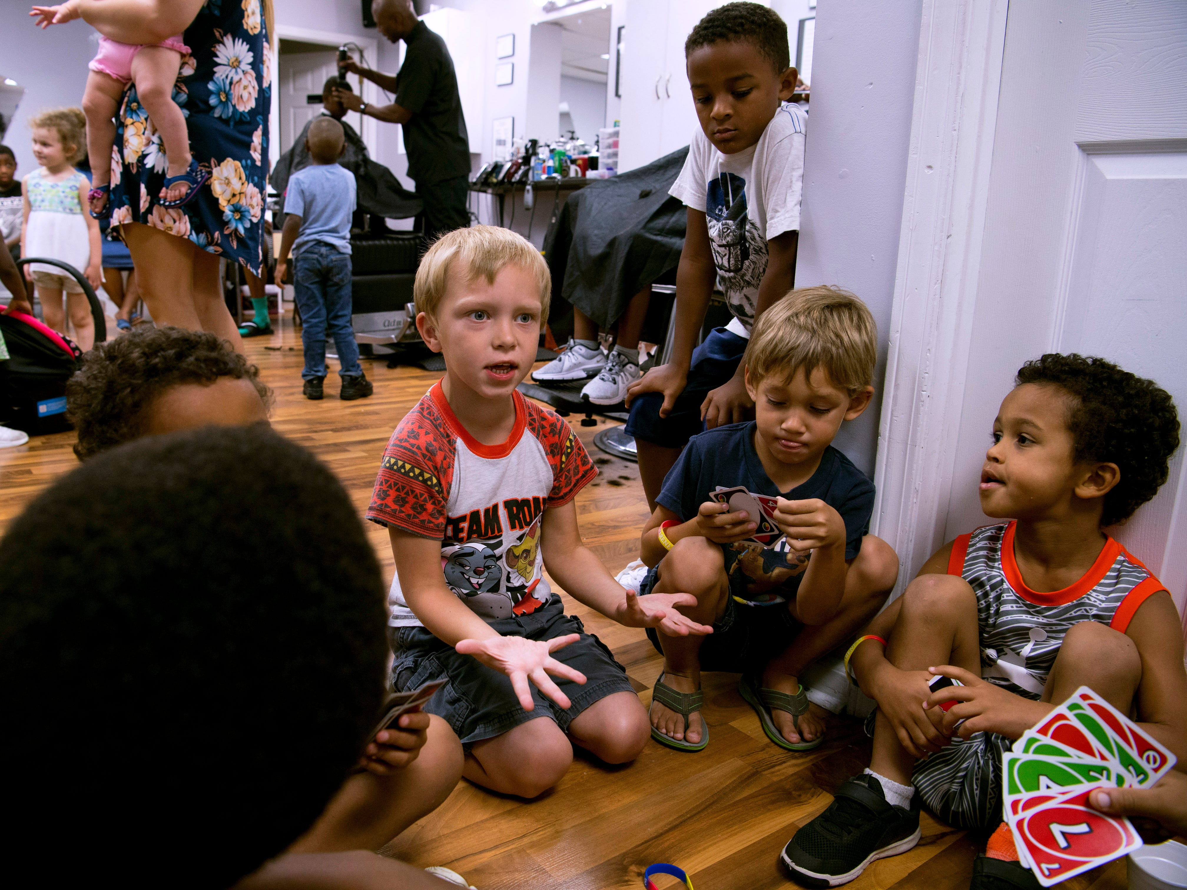 The rules for a pick-up Uno card game were seemingly made up on the fly at Jerald's Barbershop as kids waited their turns for back-to-school haircuts Monday afternoon.