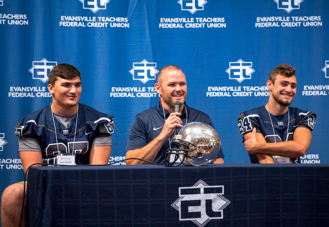 Reitz High School's Logan Maynard, left, Coach Andy Hape, center, and Andrew Word answer questions at the Courier & Press High School Media Day at Milestones Monday morning.