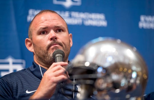 Reitz head football coach Andy Hape answers questions at the Courier & Press High School Media Day at Milestones Monday morning.