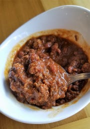 The chili at Maidens is made with a house-ground four chile spice blend, coarse beef, and a scattering of beans.