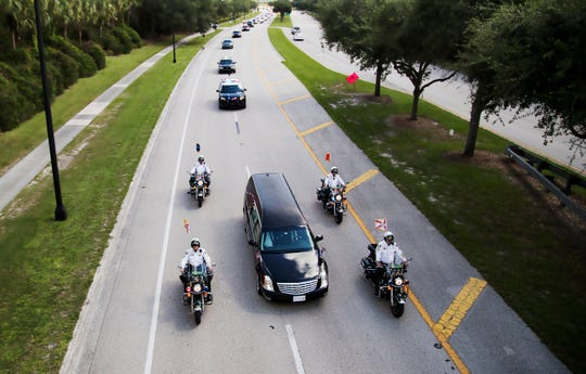 A hearse carrying the body of fallen Fort Myers police Officer Adam Jobbers-Miller is escorted by fellow officers to Germain Arena in Estero, Florida for funeral services. Jobbers-Miller was shot and killed while trying to apprehend a suspect.