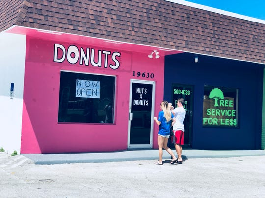 The owner of the doughnut shop said the location provides good exposure for business, but the kitchen isn't feasible for producing doughnuts. Because of this, the owner is looking for another location for production.