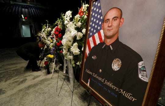 Flowers are being arranged in preparation for the funeral services of fallen FMPD officer Adam Edward Jobbers-Miller Monday morning at Germain Arena.