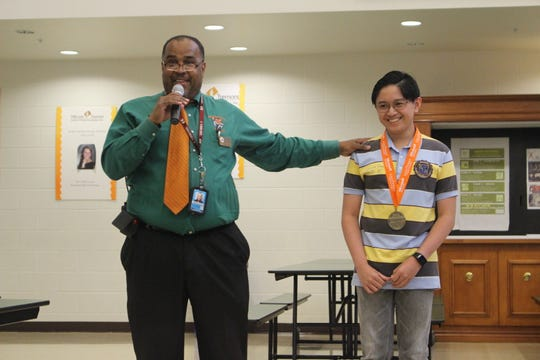 Dunbar High School Principal Carl Burnside jokes with Kevin Dimaculangan, 15, a 2018 Microsoft Excel world champion.