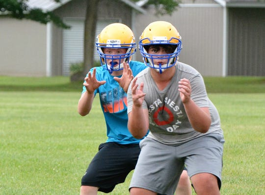 Two Oconto football team lineman drill during a practice on Friday.