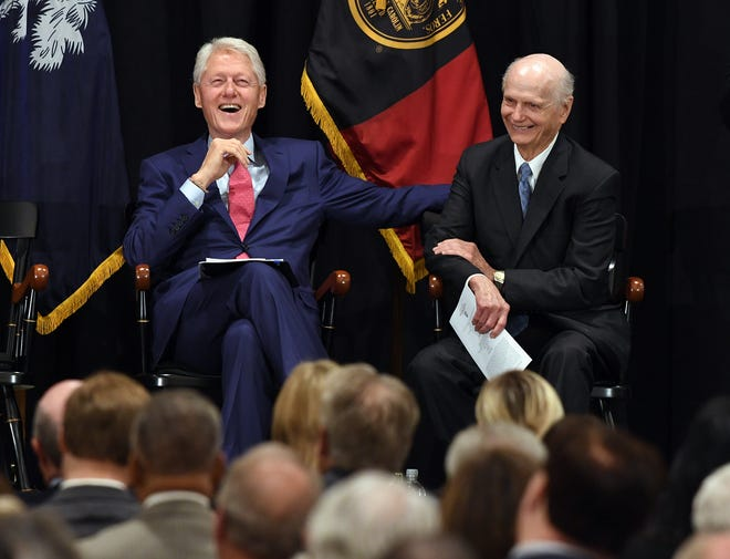 Former President of the United States Bill Clinton laughs with Sec. Richard W. Riley during a program in Columbia Monday, August 6, 2018 to introduce the Richard W. Riley Collection on display in the Ernest F. Hollings Special Collections Library of the Thomas Cooper Library located on the campus of the University of South Carolina in Columbia.
