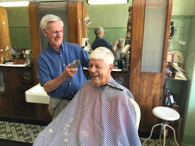 Wilburn Fulbright cuts the hair of Melvin Shaw, one of his regular customers at Dunean Barber Shop.