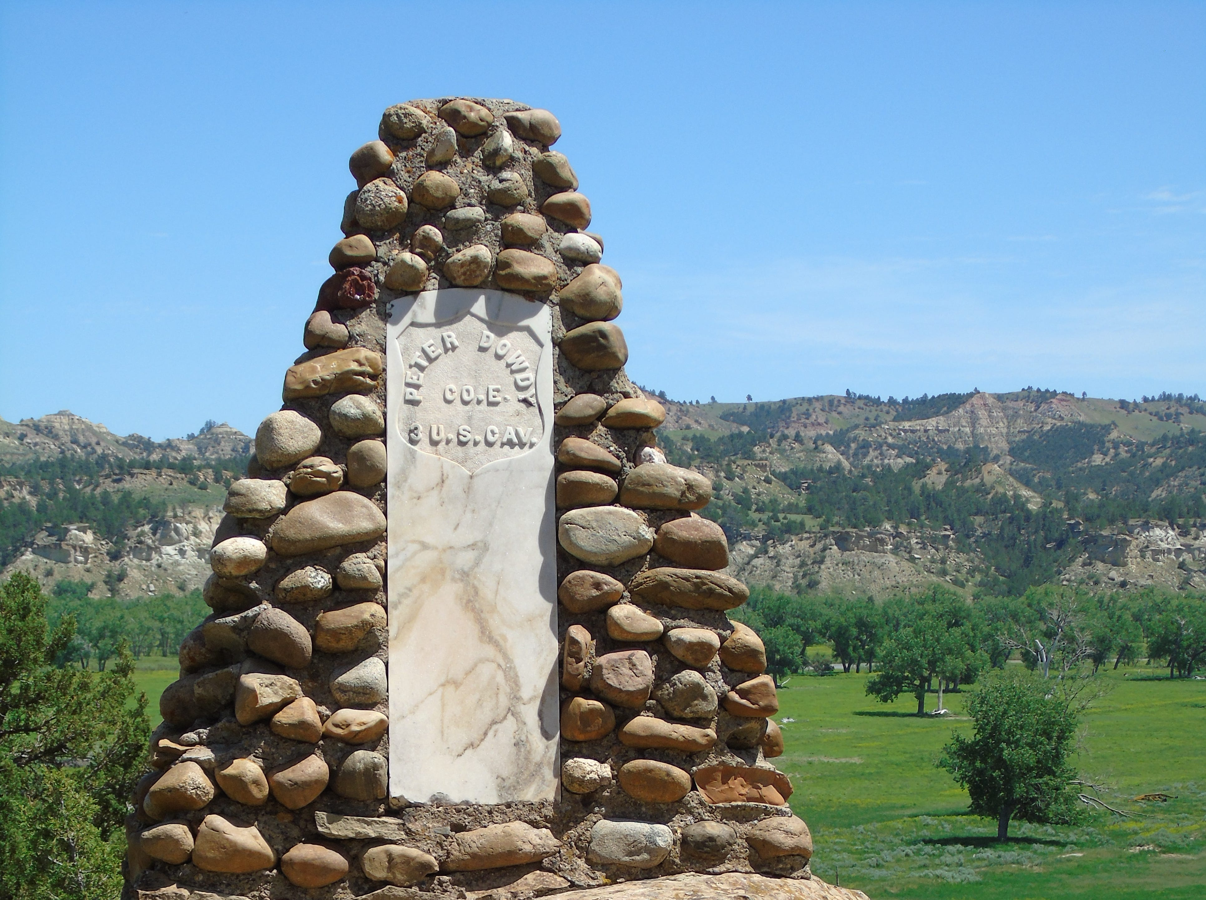 A marker recognizes four soldiers led by Col. Joseph Reynolds who were killed by Cheyenne/Sioux warriors along the Powder River on March 16, 1876. It was the first of three U.S. Cavalry defeats that year, culminating in the Battle of the Little Bighorn.
