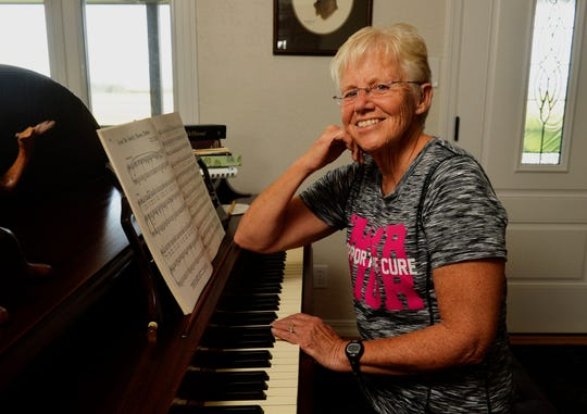 Darla Parker sits at the piano at her home in Ulm.  Parker was diagnosed with breast cancer for a second time, which has spurred life changes for her and her husband.  She incorporates walks, prayer and meditation as part of her daily wellness routine.