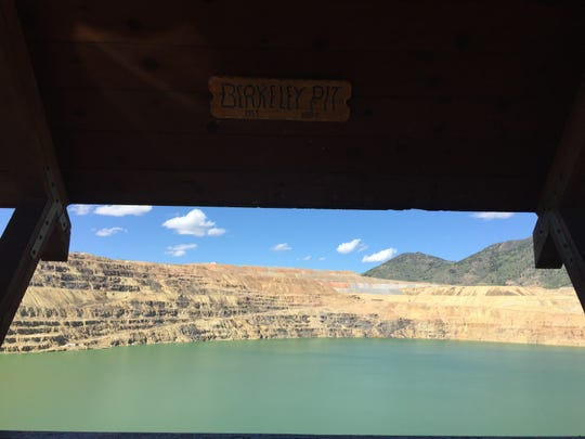 The infamous Berkeley Pit, a former open pit copper mine, is worth a stop in Butte.