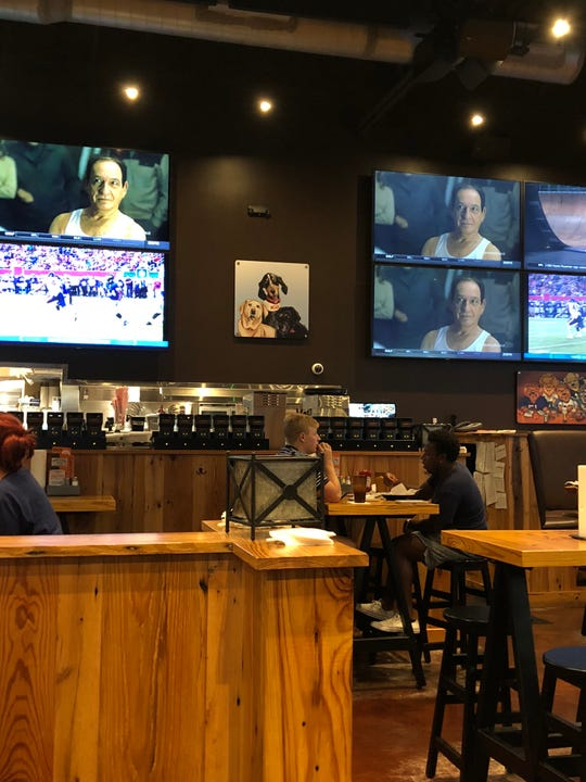 Double Dogs is anchored by lots and lots of TVs (36 screens!), paintings and photos of pups, and an open-air bar.