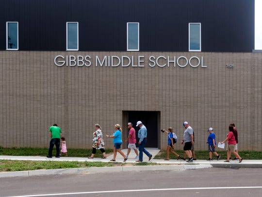 People from area churches arrive at the new Gibbs Middle School during a prayer walk on Sunday, August 5, 2018.