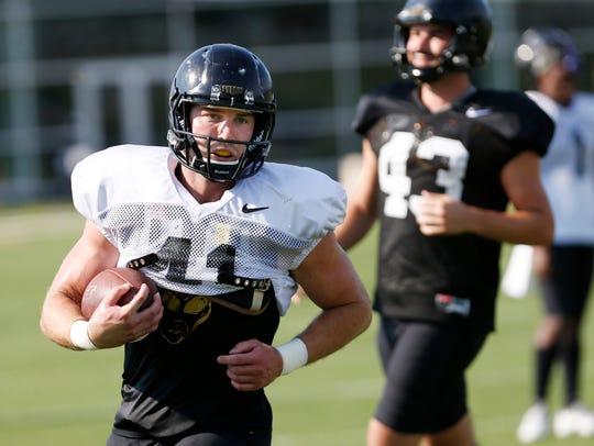 Safety Jacob Thieneman steps up to intercept a pass during a football practice drill Monday, August 6, 2018, at Purdue.