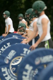 Howell football players run through tackling drills during the first day of practice on Monday, Aug. 6, 2018.